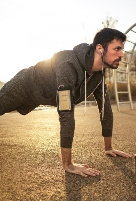 Men's Health Herbalife Products Man in a Plank Position With Headphones in His Ears