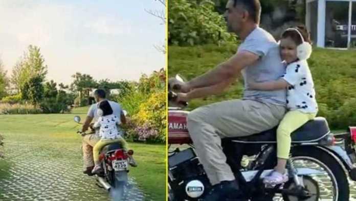 team-india-cricketer-ms-dhoni-takes-ziva-for-a-bike-ride-inside-ranchi-farmhouse