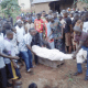 A burial at riverside for flood victim