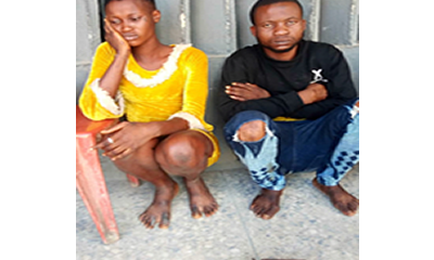 Lady, lover arrested in hotel for possession of arms