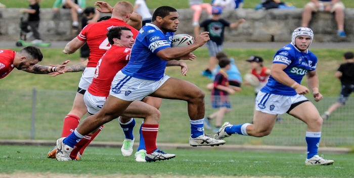 Newtown Jets front-rower Saulala Houma tears through the Illawarra Cutters defence at Henson Park on Saturday, with team-mate David Harris in close support.