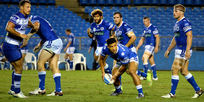 Newtown Jets halfback Fa'amanu Brown on dummy-half duty at Belmore Sports Ground on Friday night, with (from left) Junior Roqica, Jason Schirnack, Kurt Capewell and Matt McIlwrick nearest in the background. Photo: Michael Magee Photography.
