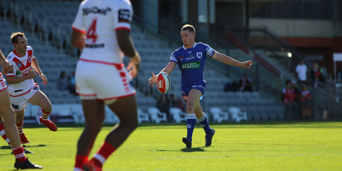 Newtown's mercurial number 6, Jack A. Williams, gets his kick away against the St George-Illawarra Dragons at WIN Stadium, Wollongong last Sunday. Photo: Gary Dover, Cronulla Sharks Media.