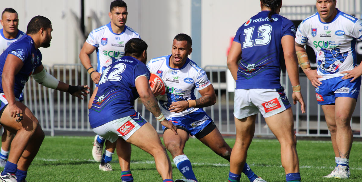 Newtown Jets winger Sione Katoa encounters a wall of New Zealand Warriors defenders in the Canterbury Cup NSW match at Mt Smart Stadium on Saturday. Photo: FitographyNZ, Joe McPhee.