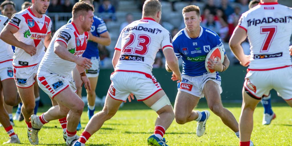Newtown Jets back-rower Teig Wilton takes on a quartet of St George-Illawarra defenders in Sunday's preliminary final. Photo: Mario Facchini, mafphotography