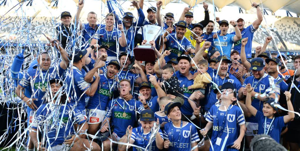 Jack A. Williams holds the Canterbury Cup NSW premiership trophy aloft in a moment of supreme triumph for the entire Newtown RLFC. Photo: Mike Magee Photography