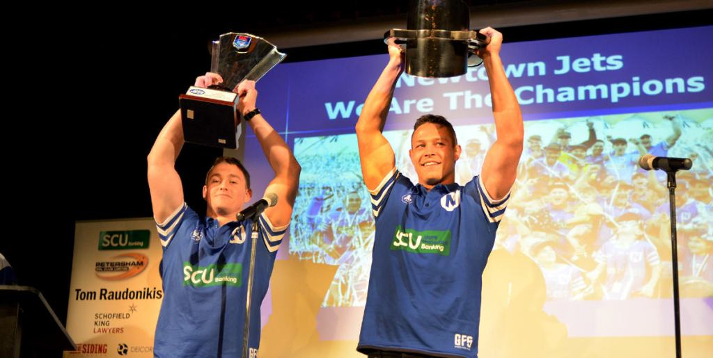 Newtown's captains Jack A. Williams (left) and Scott Sorensen (right) proudly hold aloft the two major trophies won in the club's truly remarkable 2019 season – the Canterbury Cup NSW premiership trophy (left) and the NRL State Championship Trophy (right). This photo was taken at the Mayoral Civic Reception held at the Petersham RSL Club on the evening of Wednesday, 9th October 2019. Photo: Michael Magee Photography.