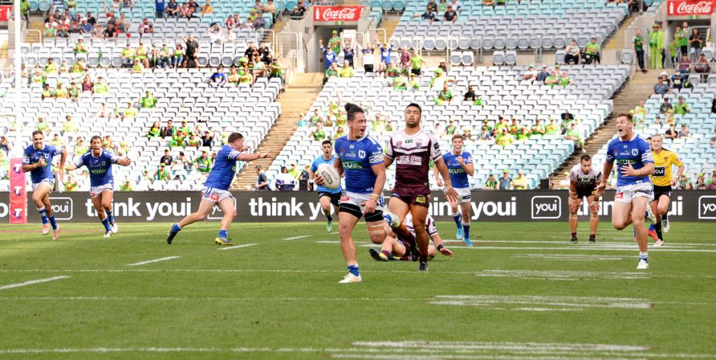 On 6th October 2019 at ANZ Stadium, the Newtown Jets defeated Burleigh Bears 20-16 in the NRL State Championship Final. This win effectively made Newtown the best club team (outside of the NRL competition) in Australia, New Zealand and Papua-New Guinea. Newtown centre Jackson Ferris (with the ball) is shown sprinting away for the winning try with less than ten seconds of regular time left to play, having seized upon a pin-point short kick by his team-mate Billy Magoulias. Newtown had trailed 10-2 at half-time and 16-14 going into the last ten seconds of the match. Photo: Michael Magee Photography