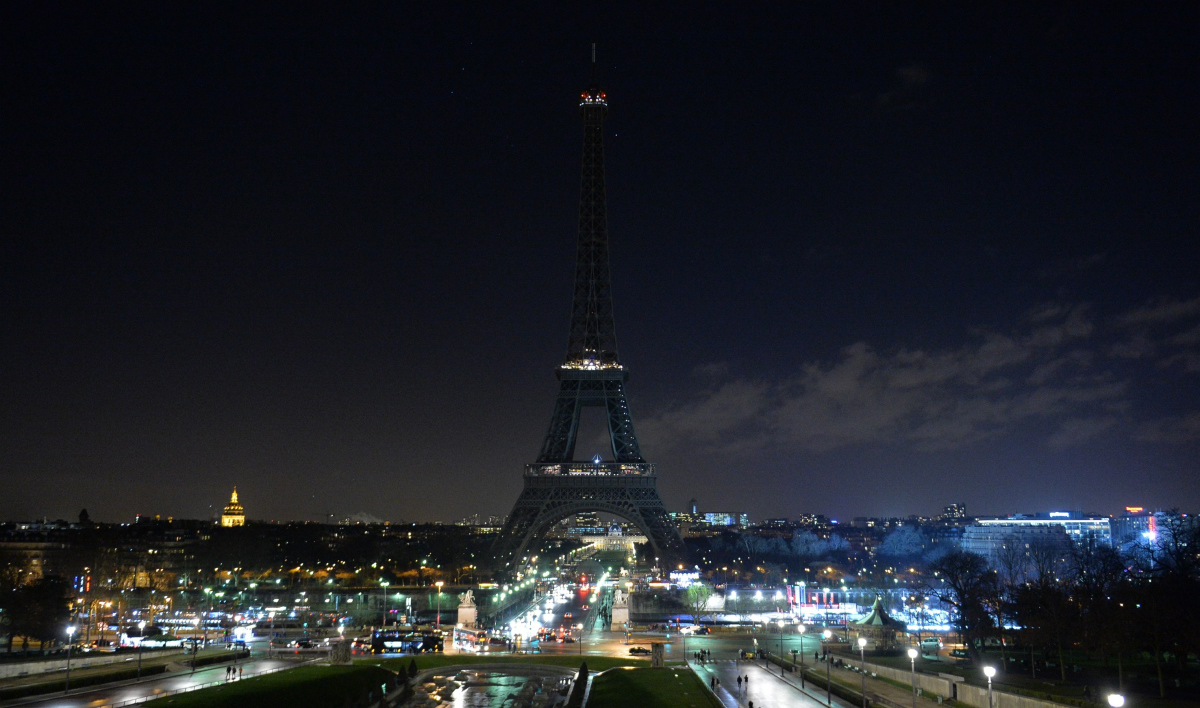 CREDIT PHOTOGRAPH BY DURSUN AYDEMIR / ANADOLU / GETTY. The Eiffel Tower after its lights were shut off in memory of the victims of the attack on Charlie Hebdo; January 8, 2015.