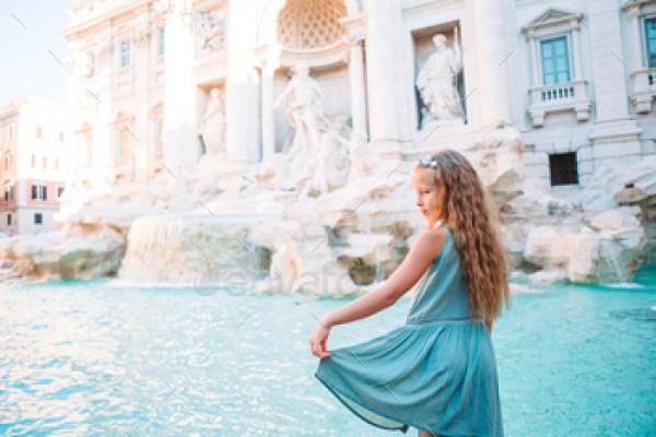Adorable little girl background Trevi Fountain, Rome, Italy