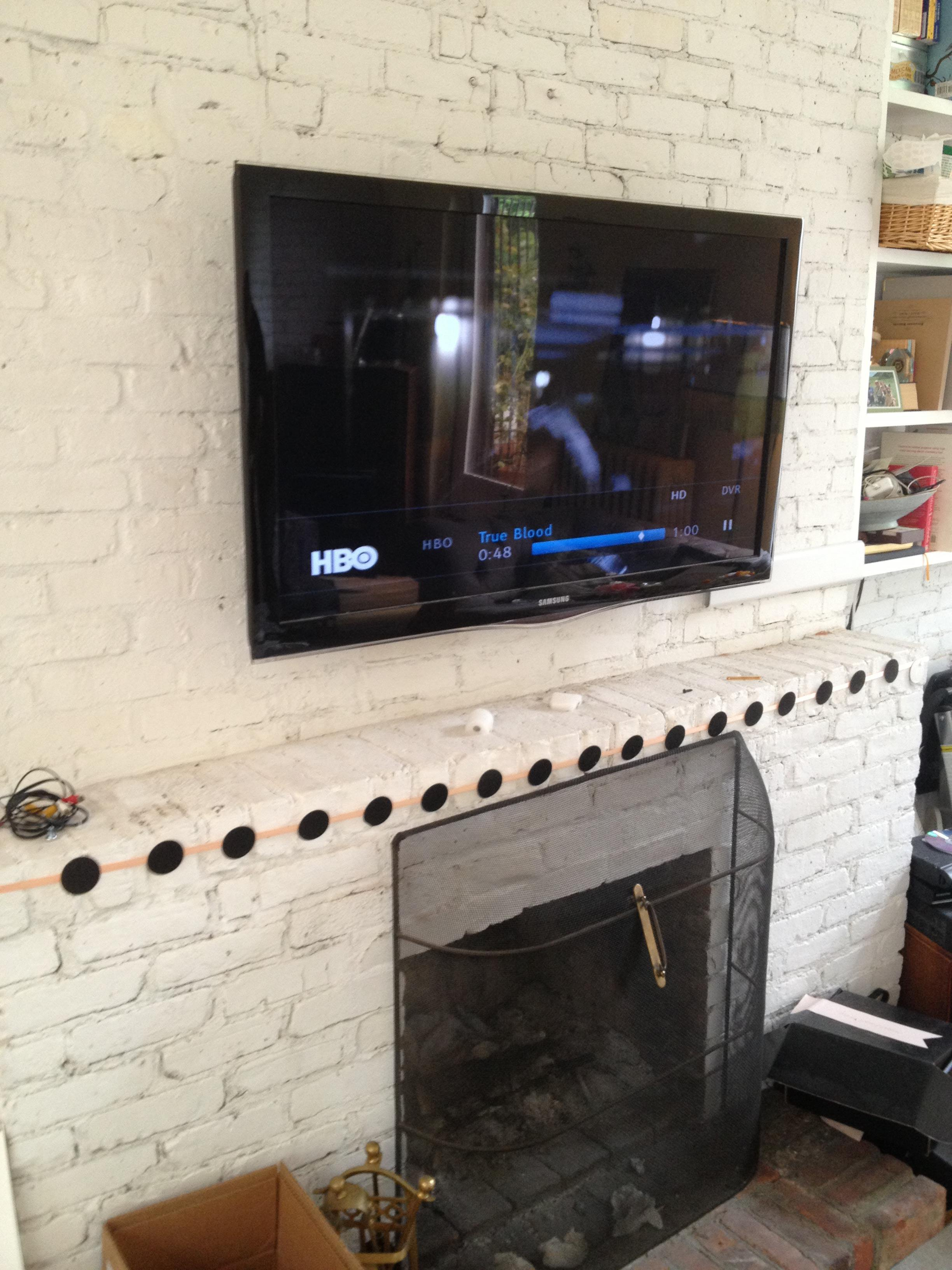 TV installation over a brick fireplace  Nextdaytechs  Onsite Technical Services