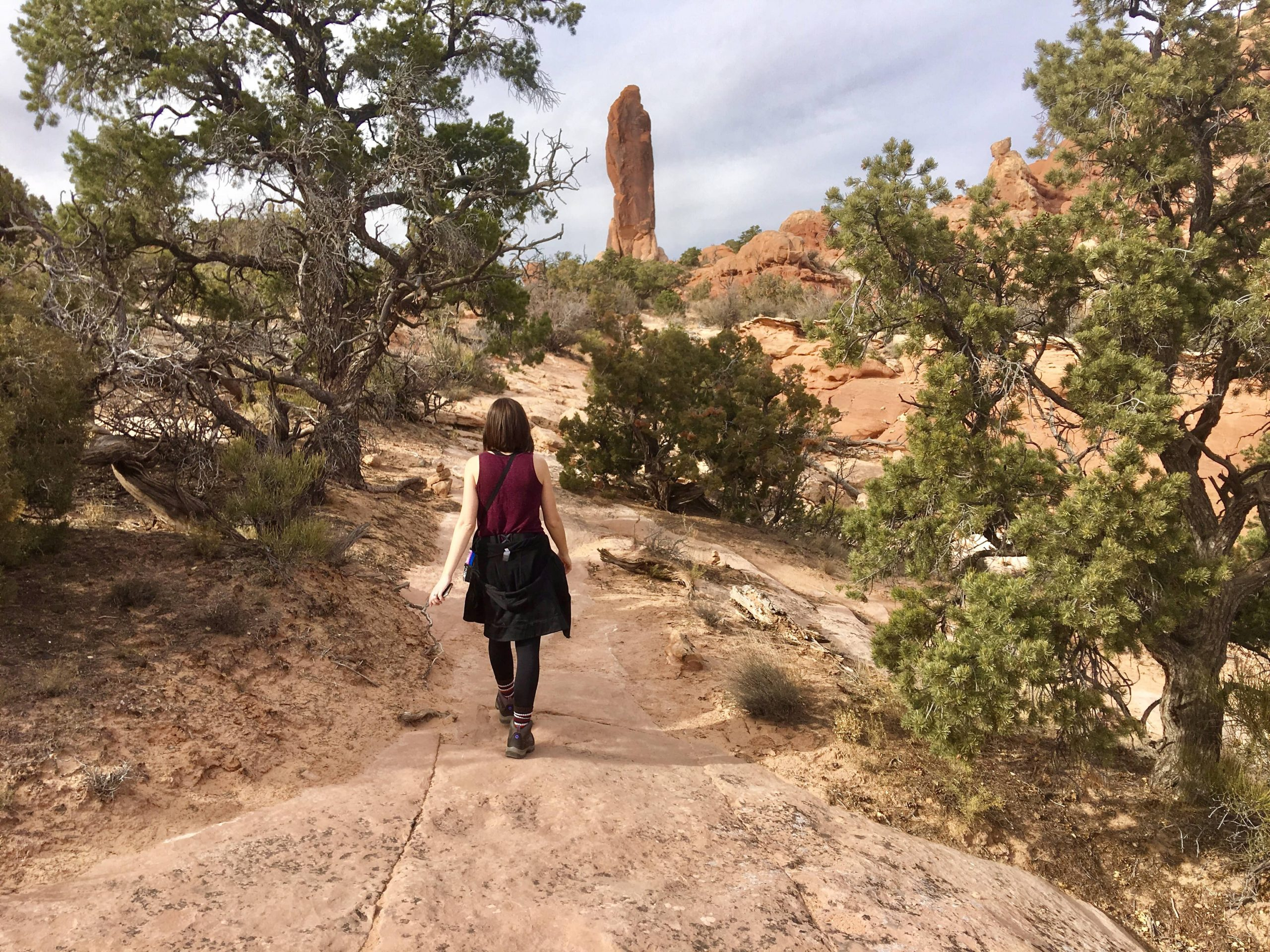 Hiking the Devils Garden Trail to the Dark Angel in Arches National Park on Utah National Parks Road Trip