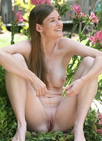 Cute natural brunette Lara Brookes nude in the garden