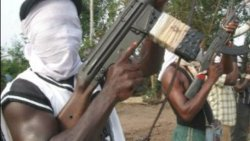Kidnappers kill 2 policemen, abduct American, Canadian