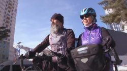 Winter Olympics: Swiss couple cycle 17,000km to watch son