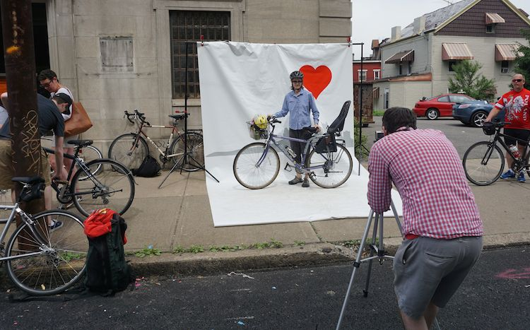 Photo, anyone? Will Bernstein shoots as cyclists line up.