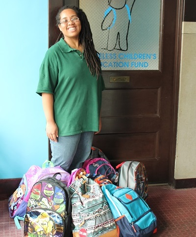 A Bright Horizons volunteer drops off donated backpacks. Image courtesy of HCEF.