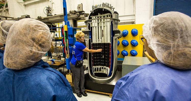 Westinghouse employee Lorrie Matisko demonstrates a mock-up of reactor vessel to a group of students at the Introduce a Girl to Engineering event at Westinghouse's Waltz Mill facility. Image courtesy of Westinghouse.