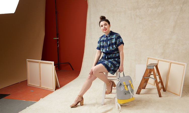 Elana Schlenker pairs a backpack with a floral romper. Image courtesy of ModCloth.