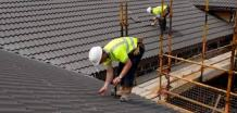 roofing experts working