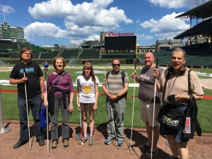 Freedom Link mentors and mentee Haley Ireland stand in front of Wrigley Field.