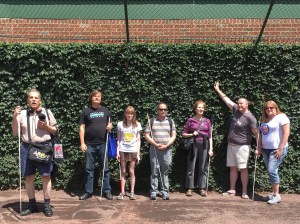 Mentee Haley Ireland and Freedom Link mentors stand in front of the famous ivy-covered wall at Wrigley Field.