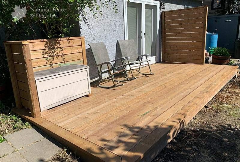 Ground level brown pressure treated deck