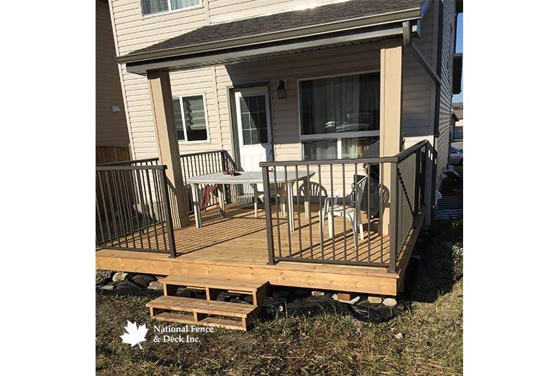 Brown Pressure Treated Deck With Bronze Aluminum Rail