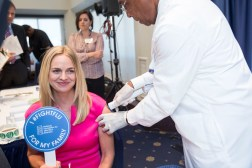 Dr. Wendy Sue Swanson, Seattle Children's, left, receives a flu vaccination from nurse Veronica Poindexter during a press conference addressing the need for flu vaccinations Thursday September 17, 2015 at the National Press Club, Washington, DC. ©Lindsay King Photography/2015
