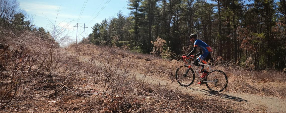 Gravel bike riding up dirt path