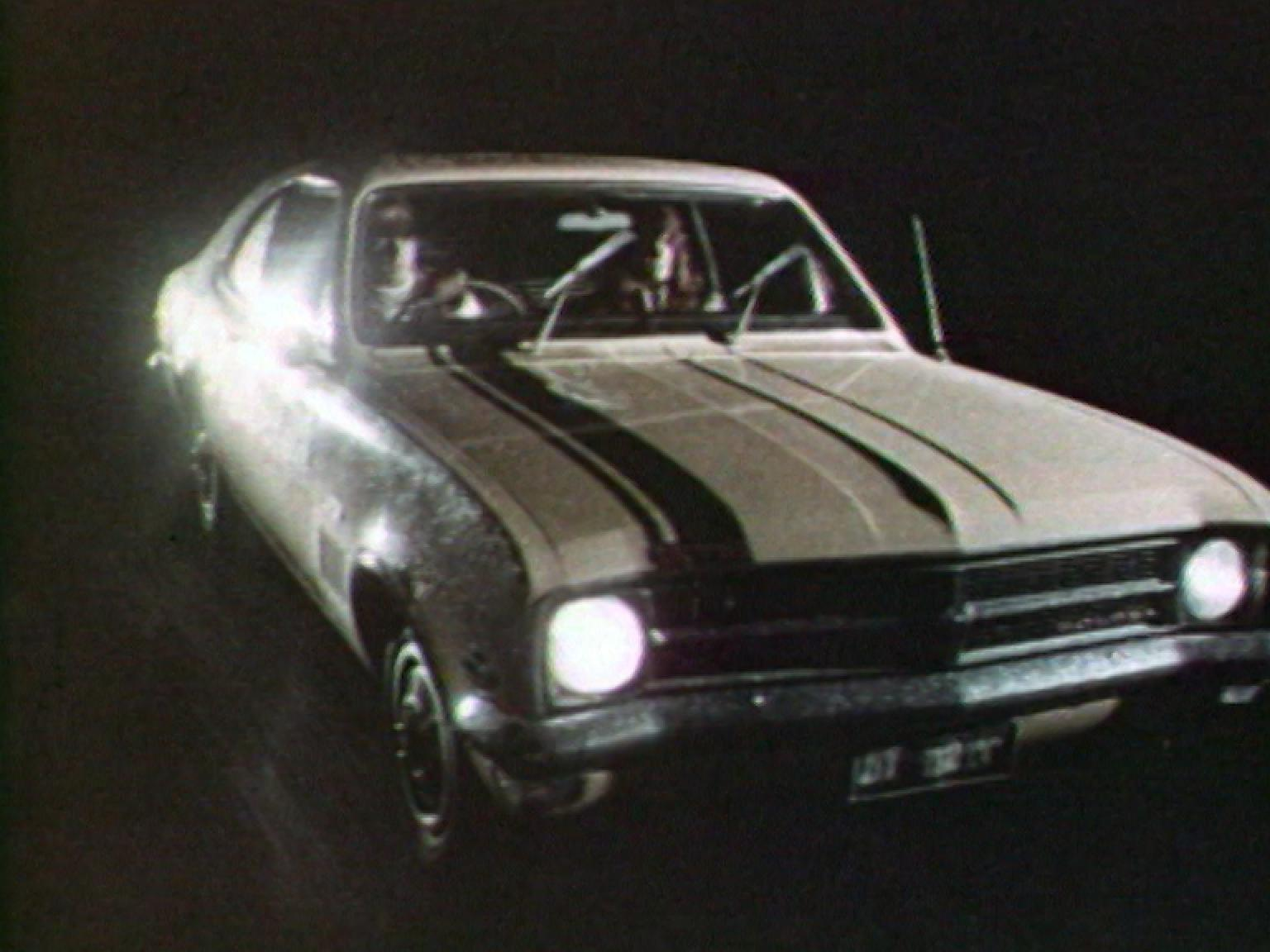 hight resolution of a holden monaro on a black background