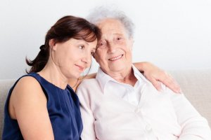phoenix caregivers with arm around elderly smiling client