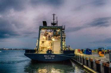 R/V Sally Ride docked at Nimitz Marine Facility with lights on