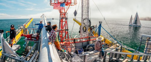 A panorama showing some members of the science team having fun as FLIP being towed out to sea. There was fog rolling over Point Loma.
