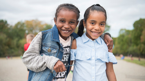 Two students enjoying recess also discover our difference grand rapids mi excel charter academy rh nhaschools