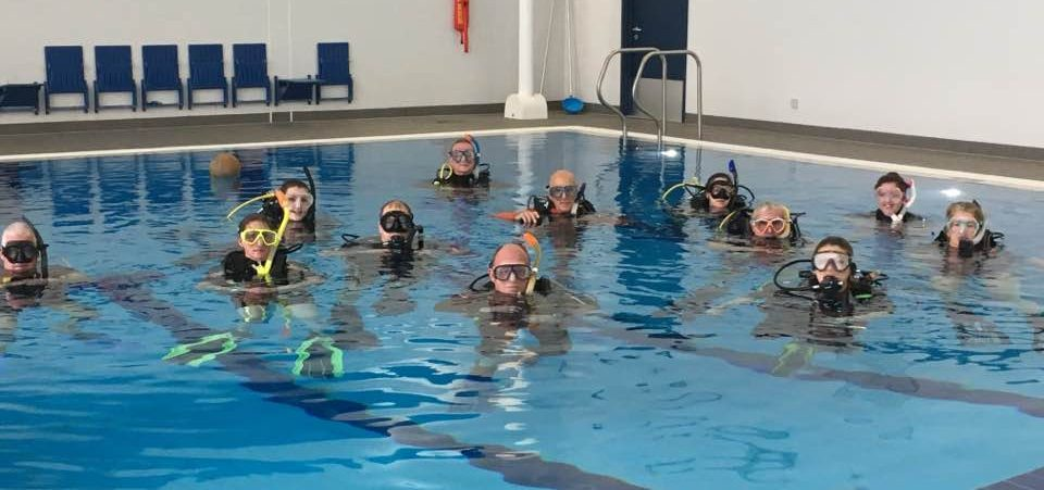 A pool with 13 people on the surface.  Why we teach how we teach started here.