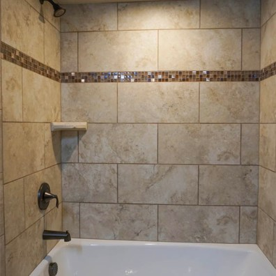 Custom tile work i n176 night hawk's hall bathroom