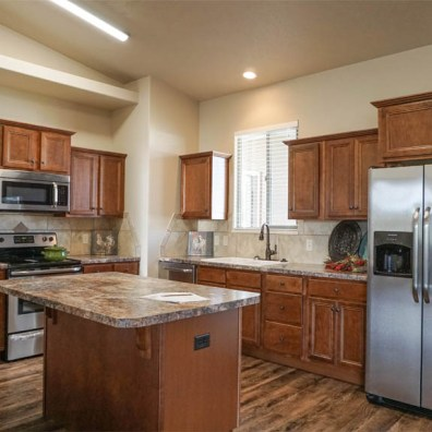 Kitchen has an island, pantry, & includes all appliances