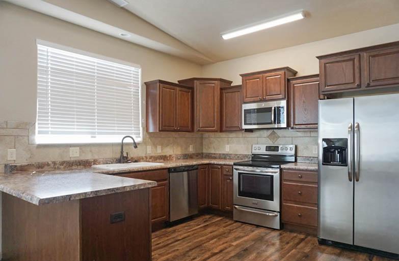 The kitchen in 170 Night Hawk includes a breakfast bar