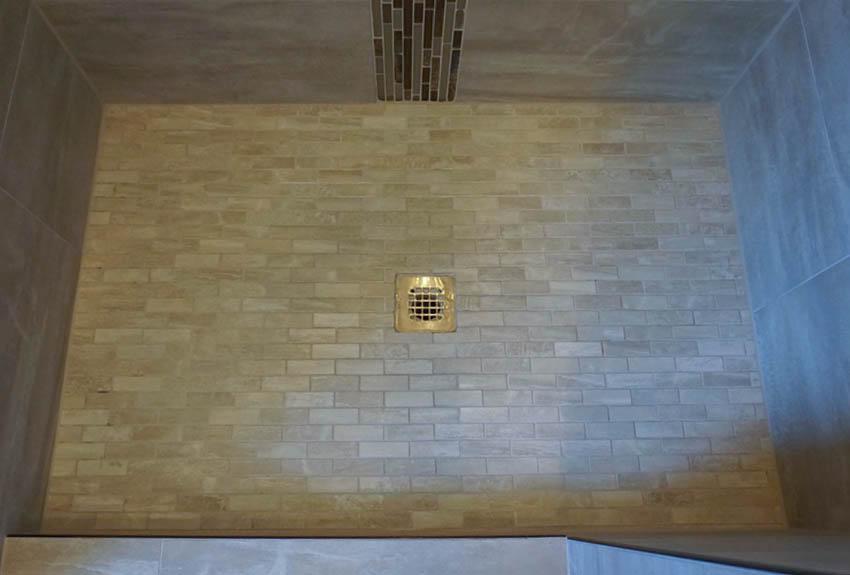 Custom tiled floor pan in 188 Night Hawk's master shower.