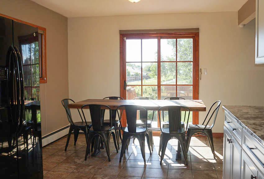 Dining Room of 2575 Young Court allows access to the side yard & garden area.