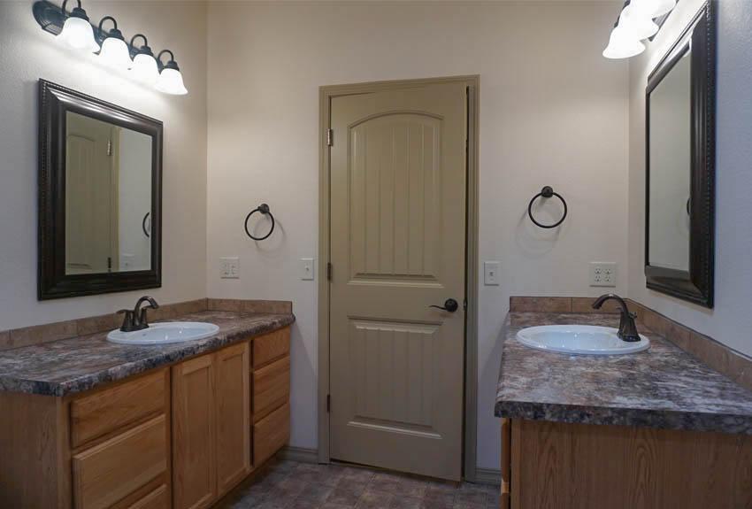 Double vanities in the hall bath of 2997 Black Hawk Way