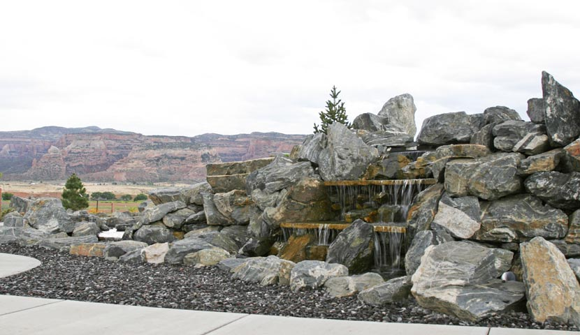 Custom built granite double sided waterfall in the private park of Adobe Falls Subdivision.