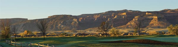 View of the Colorado National Monument across the Adobe Creek National Golf Course and Adobe Falls Subdivision at sunrise.