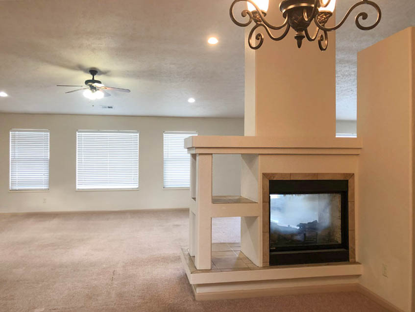 177 Winter Hawk features a double-sided gas fireplace between the living & family rooms
