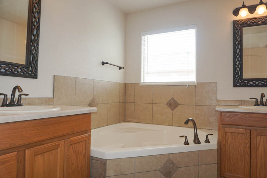 The master bath includes a corner soaking tub, step-in shower, and double vanities!