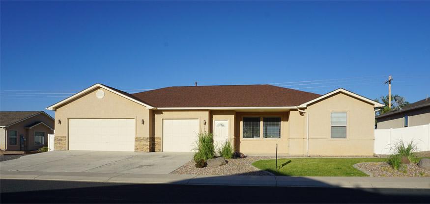 182 Sun Hawk Drive, 3 bedroom, 2 bath, 3-car garage home on Orchard Mesa with incredible views of the Grand Mesa