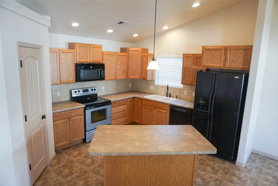 the kitchen of 199 Winter Hawk includes an eat-at island, walk-in pantry, and all appliances.