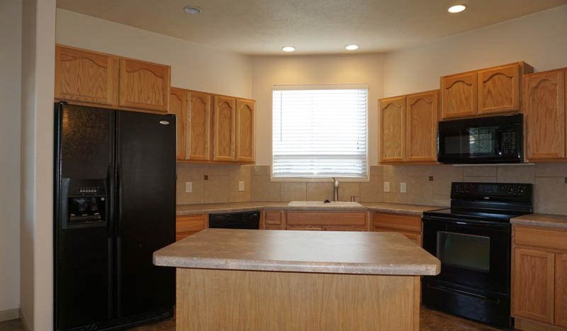 The kitchen of 2995 Golden Hawk includes all appliances, a storage island with seating, and a walk-in pantry!