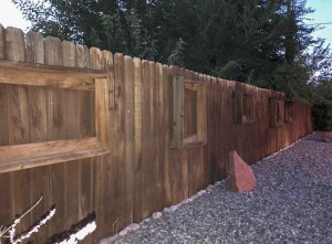 The back fence of 535 Oriole has picture frame shelves